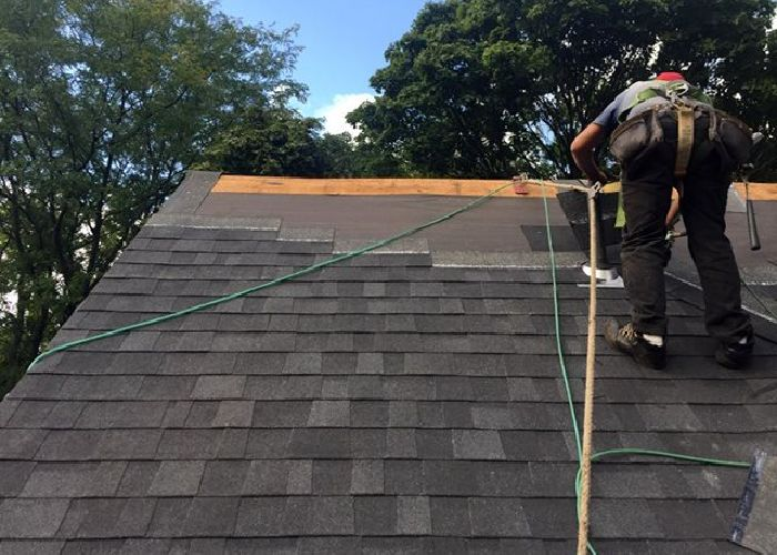 working on commercial roof repair in Providence